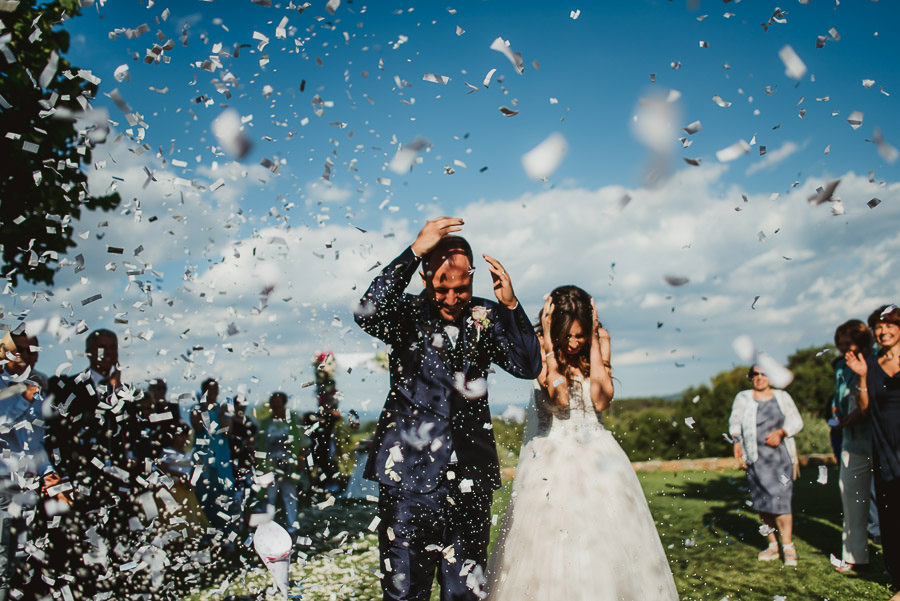 italian style outdoor wedding ceremony, confetti throwing, rice