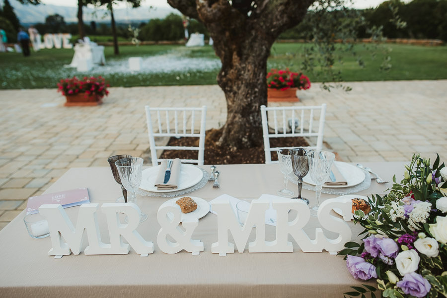 italian style outdoor wedding ceremony, having fun with guests