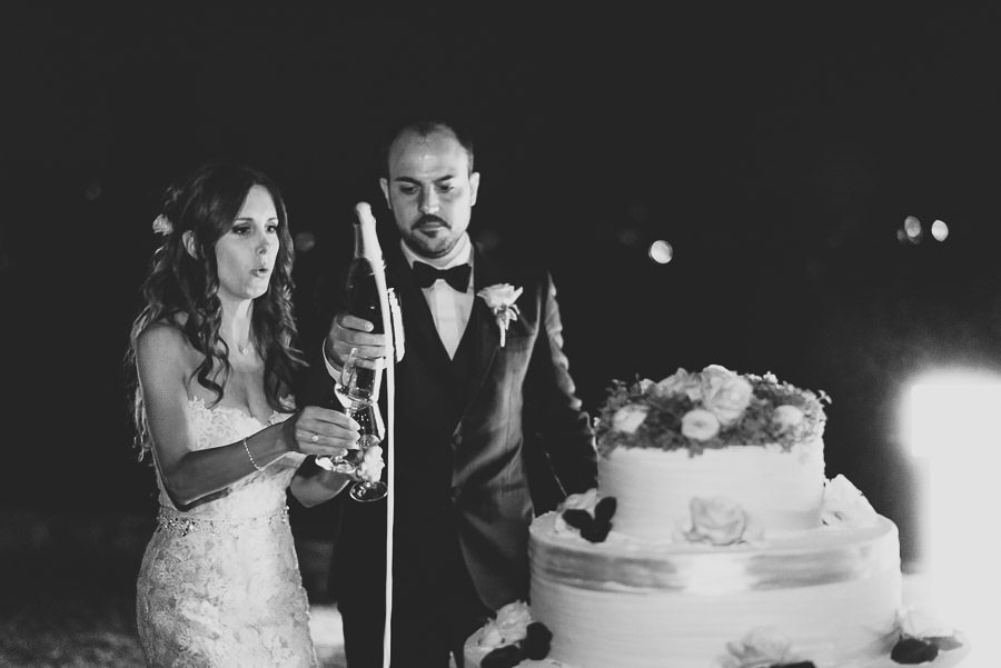 italian style outdoor wedding ceremony, cake cutting