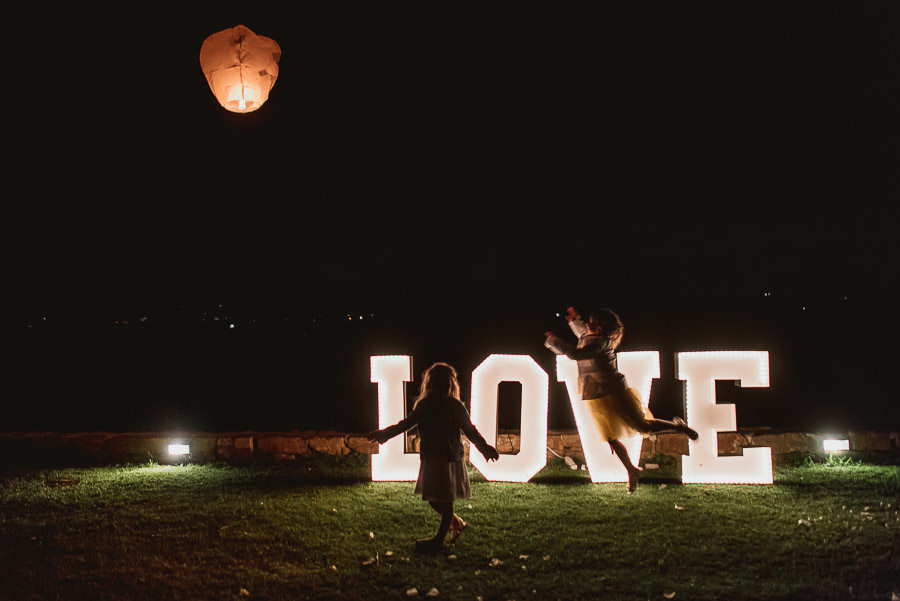 italian style outdoor wedding ceremony, firing wedding lantern