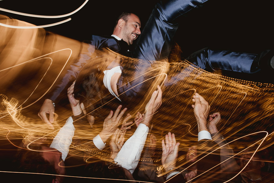 italian style outdoor wedding ceremony, guests dance and party