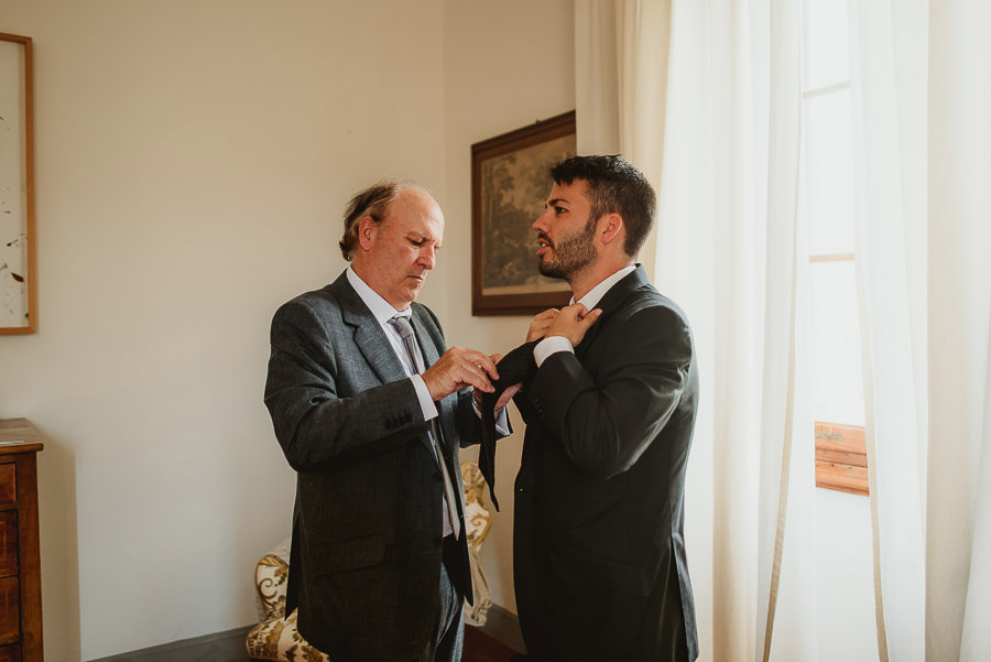 destination wedding in italy groom getting ready photography
