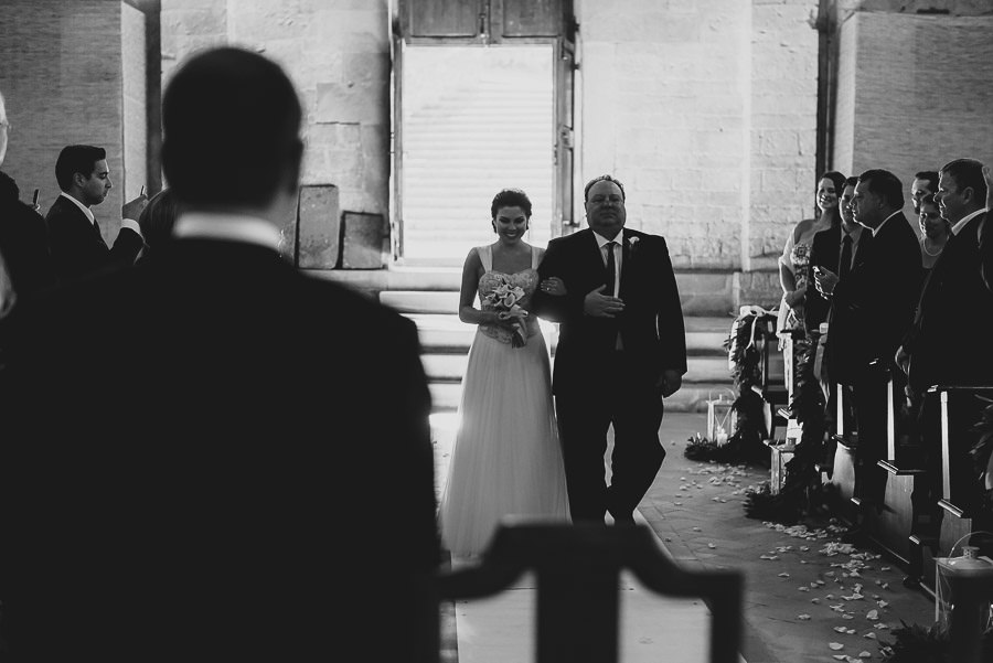 tuscany intimate wedding bride arrival in church with father