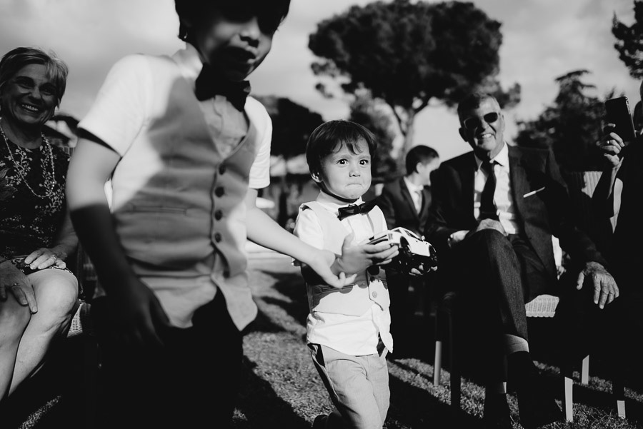 relaxed wedding in Tuscan Villa wedding ceremony kids bring rin