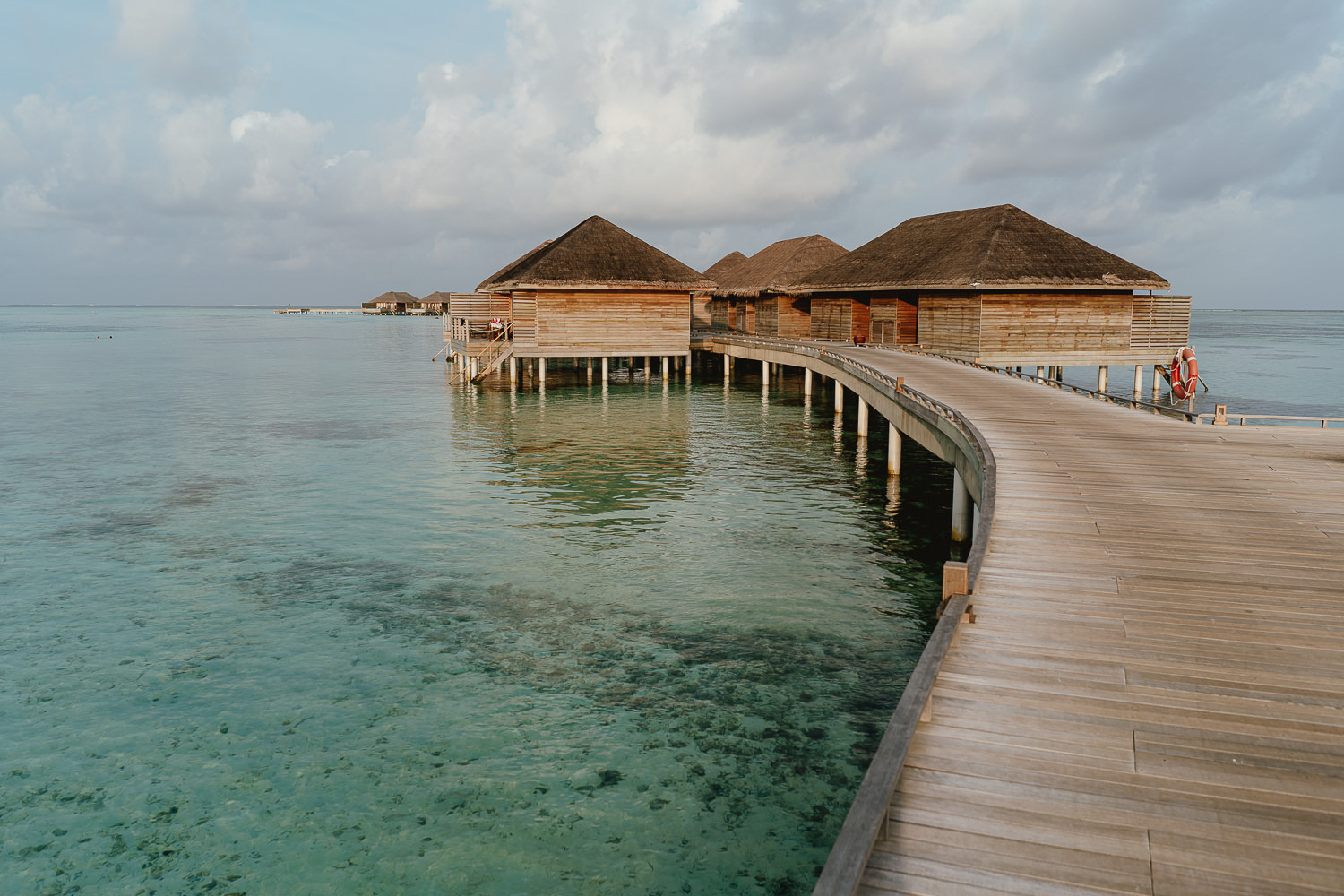 village maldives pier