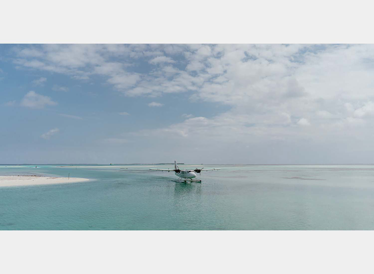 wedding photographer in maldives anniversary trip private sandbank affairs canoe dugout