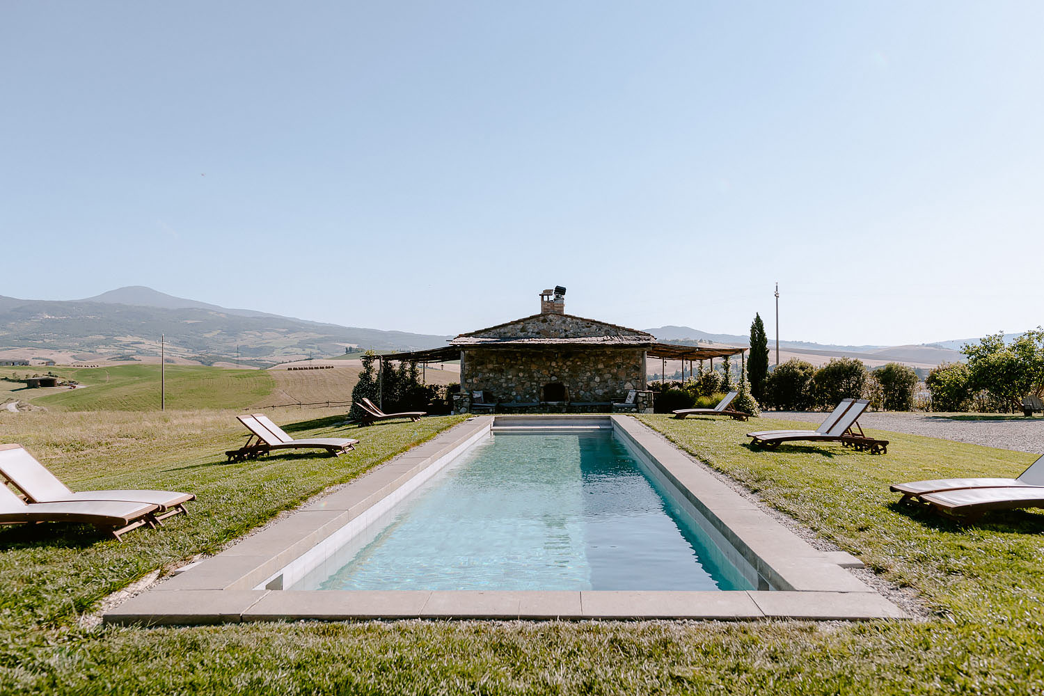 Wedding Inspiration Tuscan Rolling Hills locanda in tuscany view by the pool
