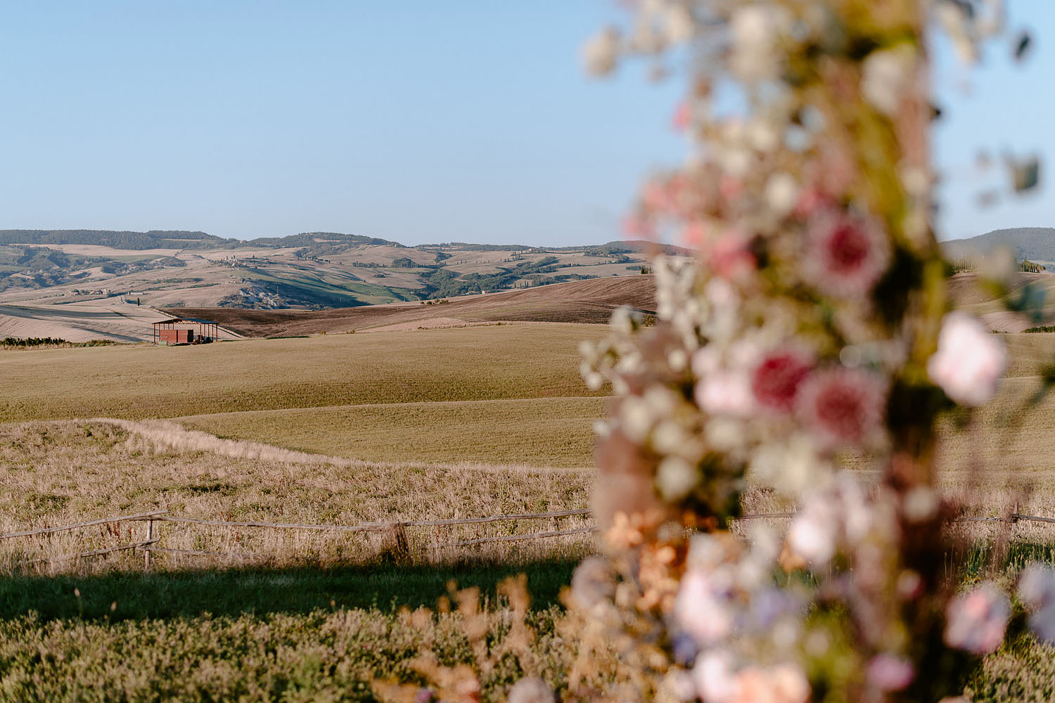 editorial intimate Wedding Inspiration in Tuscan Rolling Hills val d orcia rolling hills view by wedding ceremony spot