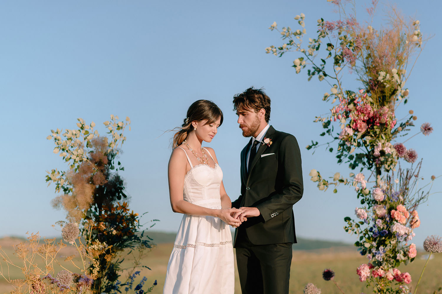 editorial Wedding Inspiration Tuscan Rolling Hills ceremony setup puscina flowers and eventset