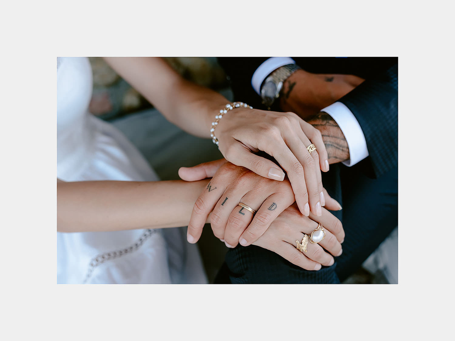 intimate Wedding Inspiration Tuscan Rolling Hills bride and groom rings hands detail