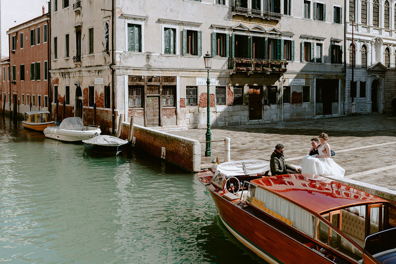 wedding photographer venice elopement photography bride water taxi ride glossy rooftop