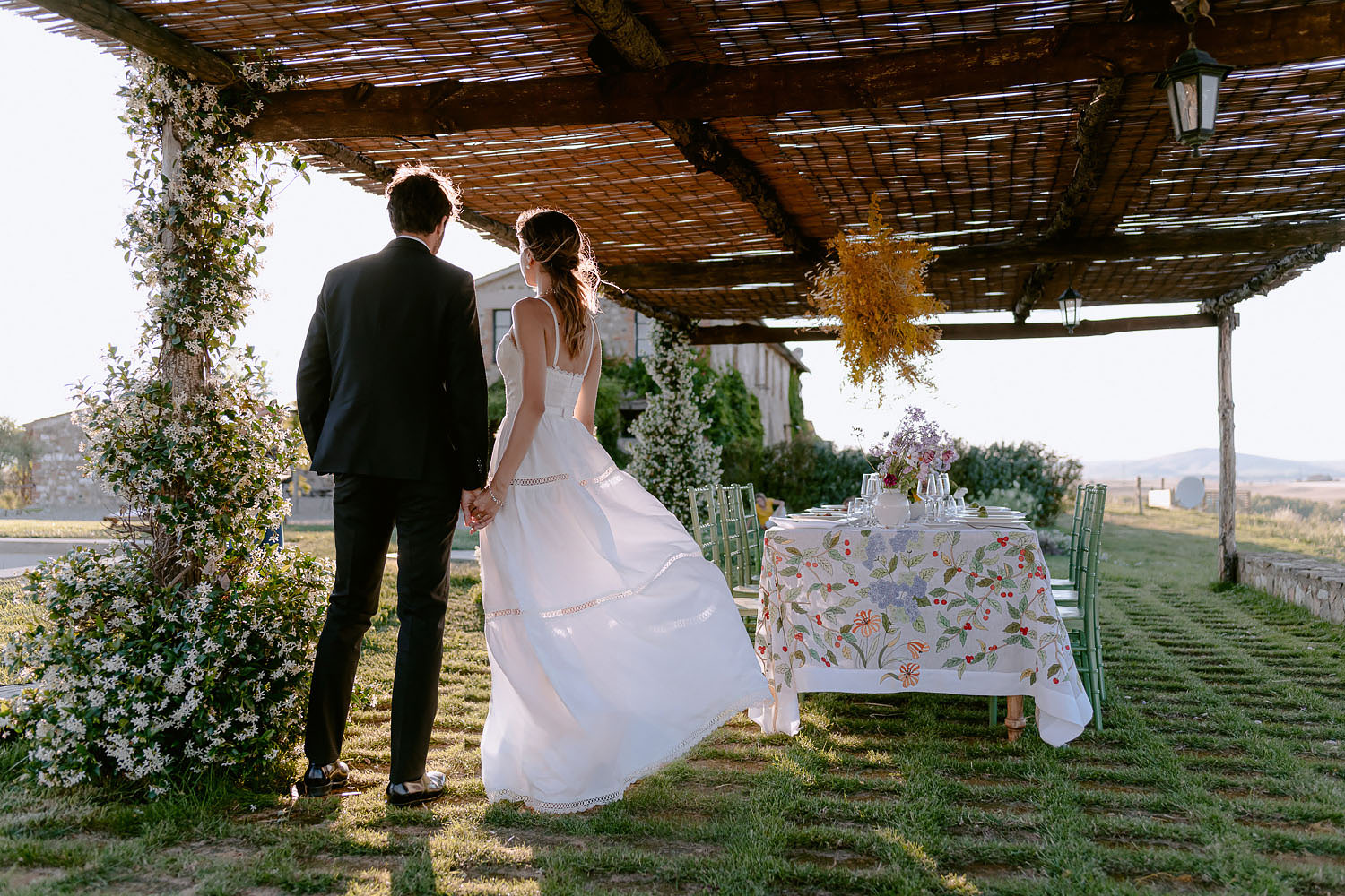 editorial intimate Wedding Inspiration Tuscan Rolling Hills bride and groom portrait at dinnet table place