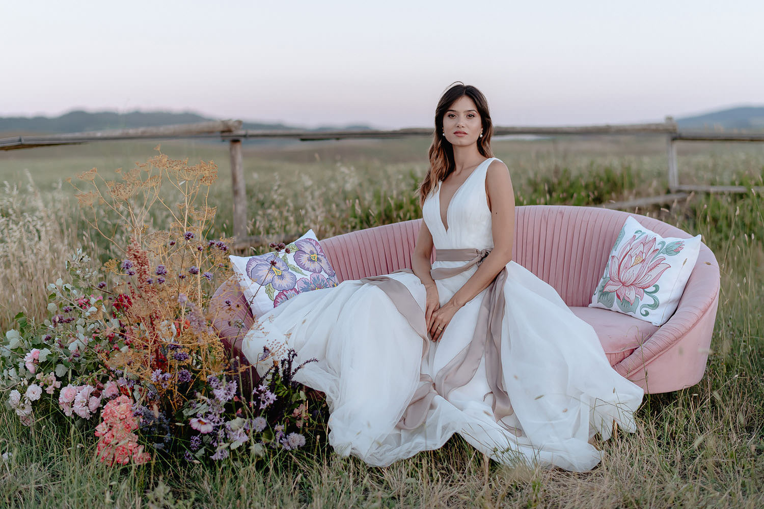 editorial intimate Wedding Inspiration in Tuscan Rolling Hills bride sunset tuscan field sofa fascion vibe