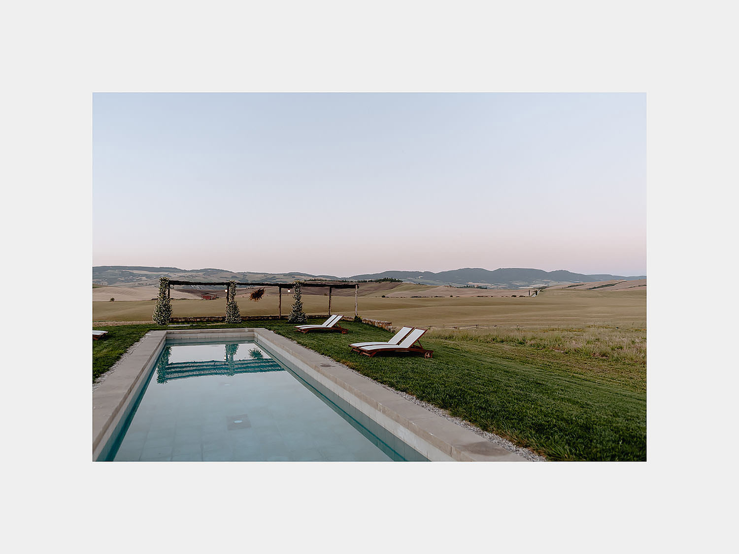 intimate Wedding Inspiration Tuscan Rolling Hills val d orcia locanda in tuscany at sunset pool