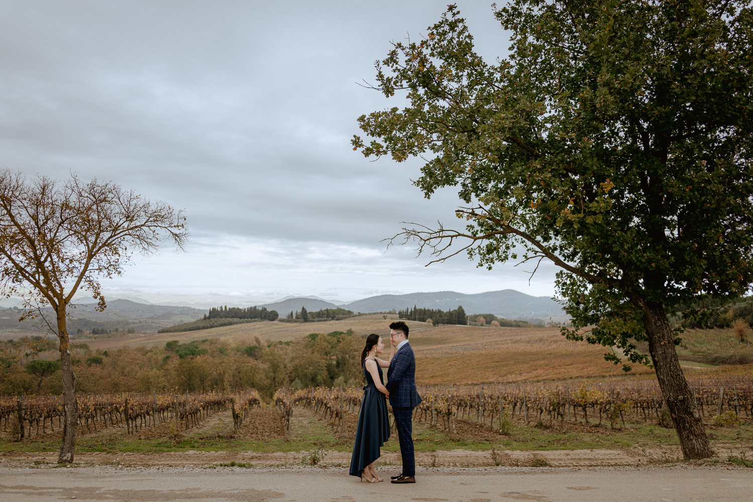 winter wedding proposal tuscany chianti going down knee between rolling hills