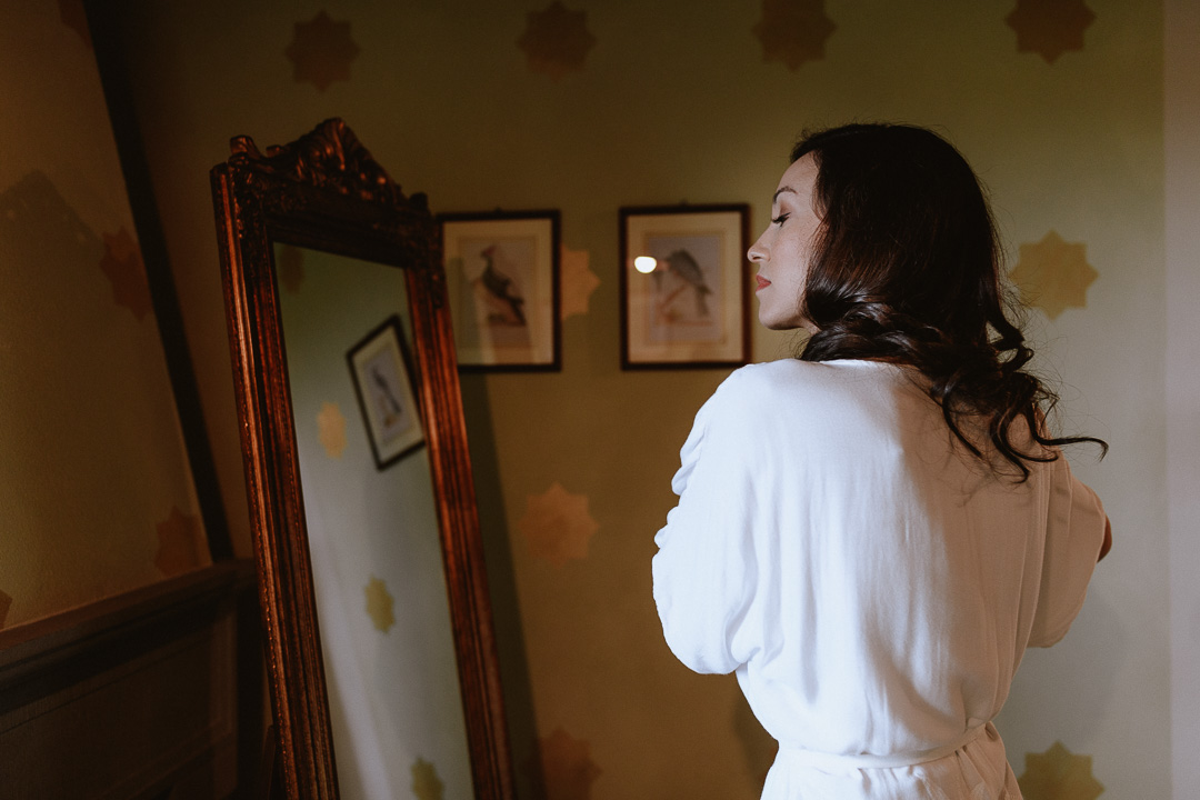 bride getting ready at intimate wedding