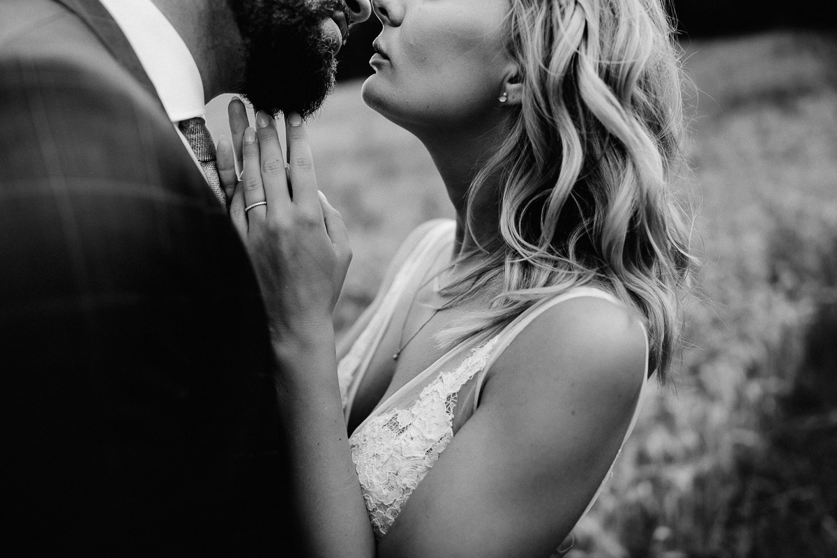 intimate bridal couple first kiss